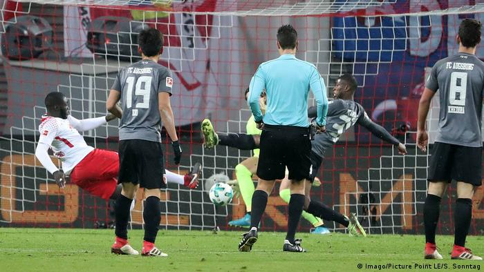 Upamecano's first senior goal sets up Leipzig win