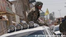 epa05620114 (FILE) A file photograph dated 23 June 2015 showing a member of Kurdish People Defence Units (YPG) sitting on a truck after coming from the Syrian town of al-Raqqa, in Tel Abyad, Syria. Reports state the Syrian Democratic Forces (SDF) announced on 06 November 2016 that it had started a military campaign to liberate the northern Syrian city of Raqqa, the main stronghold of the Islamic State militant group in Syria. SDF is an umbrella group gathering Kurdish and Arab rebels fighting in Syria. EPA/SEDAT SUNA |