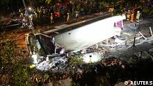 Rescuers work at the site of a crashed bus in Hong Kong