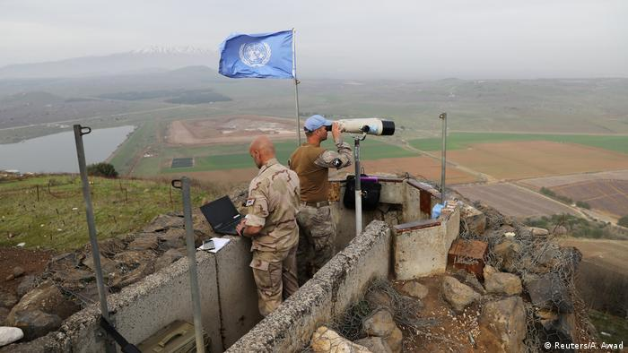 UN soldiers look out on a post at Mount Avital, in the Israeli-occupied Golan Heights