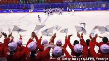 North Korean cheerleaders at Olympic hockey match (Getty Images/AFP/J. Yeon-Je)