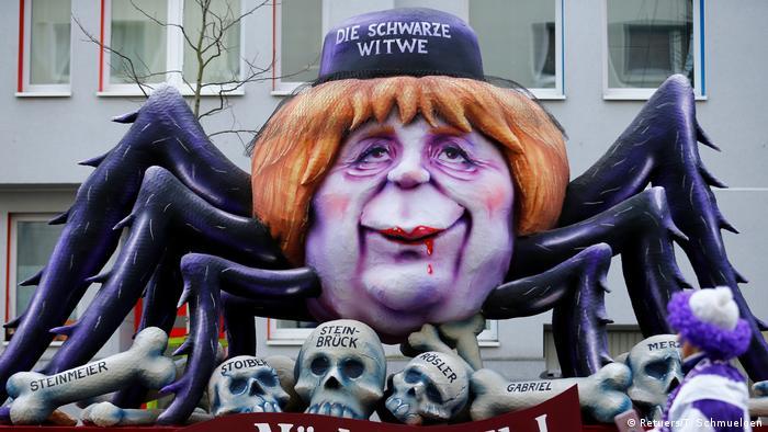 Merkel as black widow (Retuers/T. Schmuelgen)
