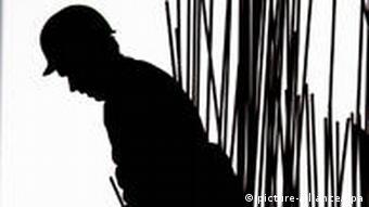 Backlit construction worker