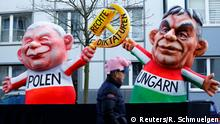 A carnival float depicting leader of the ruling party Law and Justice (PiS) in Poland Jaroslaw Kaczynski and Hungarian Prime Minister Viktor Orban at the traditional Rosenmontag Rose Monday carnival parade in Duesseldorf, Germany, February 12, 2018. REUTERS/Thilo Schmuelgen