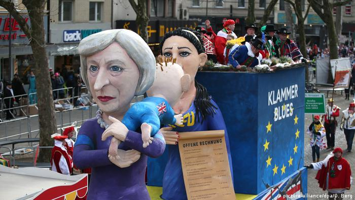 One of the stands at a carnival in Cologne see UK PM May holding a Brexit baby