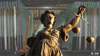 Statue of a woman holding up the scales of justice