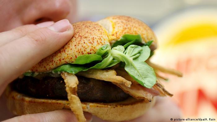 Person biting into a fast food hamburger