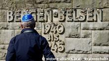 ARCHIV - 24.04.2015, Niedersachsen, Bergen-Belsen: Ein Holocaust-Überlebender steht in der Gedenkstätte Bergen-Belsen. Derzeit wird über die Besetzung des Stiftungsrats diskutiert. (zu dpa vom 12.02.2018) Foto: Julian Stratenschulte/dpa +++(c) dpa - Bildfunk+++ | Verwendung weltweit