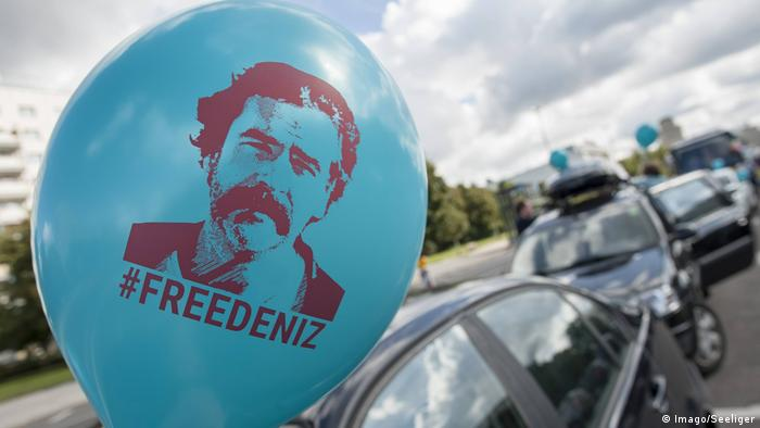 Protesters demand the release of Deniz Yücel