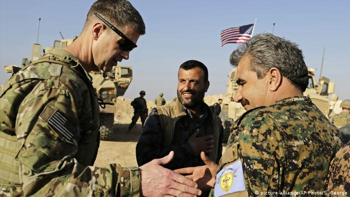 U.S. Army Maj. Gen. Jamie Jarrard left, thanks Manbij Military Council commander Muhammed Abu Adeel during a visit to a small outpost near the town of Manbij, northern Syria