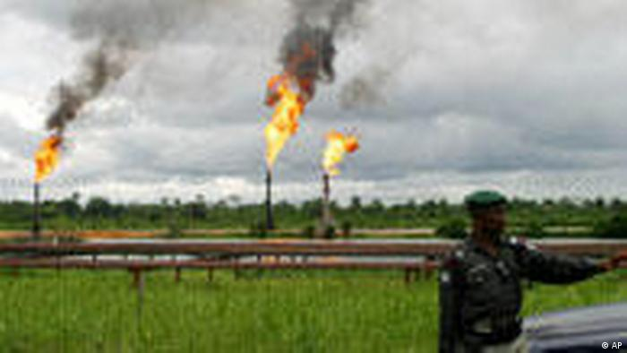A security official stands inffront of oil and gas pipelines in Nigeria's Niger Delta.