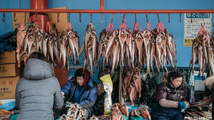 Gangeung street scene with fish sellers, South Korea, Winter Olympics (Jun Michael Park)
