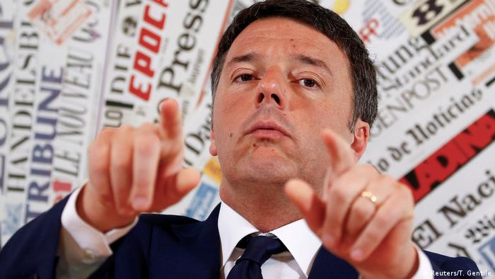 Matteo Renzi gestures during a news conference