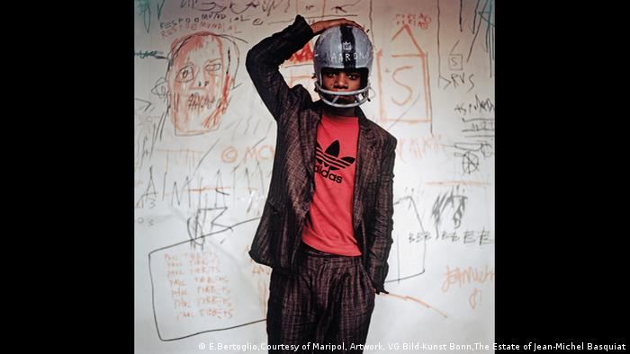 Jean-Michel Basquiat with a football helmet, 1981 (E.Bertoglio,Courtesy of Maripol, Artwork, VG Bild-Kunst Bonn,The Estate of Jean-Michel Basquiat)