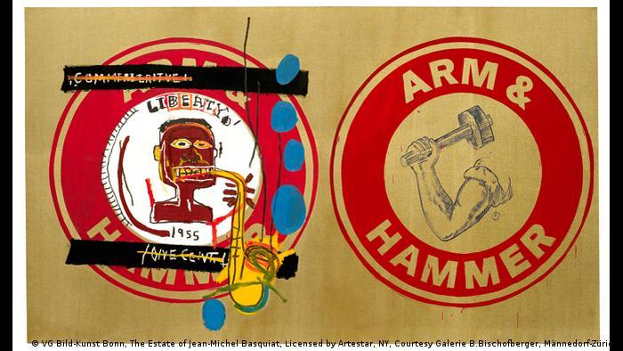 Jean-Michel Basquiat und Andy Warhol, Arm und Hammer II, 1984. Zwei Industrielogos mit dem Schriftzug Arm and Hammer, das linke hat Basquiat mit einem Bildnis von Charlie Parker übermalt, der Saxophon spielt. Acryl auf Leinwand (VG Bild-Kunst Bonn, The Estate of Jean-Michel Basquiat, Licensed by Artestar, NY, Courtesy Galerie B.Bischofberger, Männedorf-Zürich)