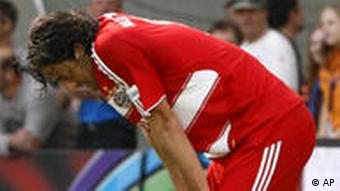 Luca Toni from Munich reacts after the 2-2 draw in the German first division Bundesliga soccer match between TSG 1899 Hoffenheim and FC Bayern Munich in Sinsheim, southwestern Germany, on Saturday, May 16, 2009.
