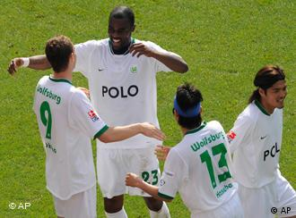 Wolfsburg's Edin Dzeko, left, is congratulated by his teammates, Yoshito Okubo, Makoto Hasebe and Grafite, from left, after scoring their side's fifth goal during the German first division Bundesliga soccer match between Hanover 96 and VfL Wolfsburg in Hanover, Germany, on Saturday, May 16, 2009. Wolfsburg won by 5-0.