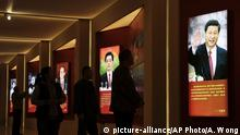 Visitors walk past images of China's past and present leaders, from left, Mao Zedong, Deng Xiaoping, Jiang Zemin, Hu Jintao and Xi Jinping on display at an exhibition on the Long March at the military museum in Beijing, Monday, Oct. 24, 2016. Having punished more than a million Communist Party members for corruption, current President Xi will use a key meeting that started Monday to drive home the message that his signature anti-graft campaign is far from over and that his authority remains undiminished. (AP Photo/Andy Wong) |