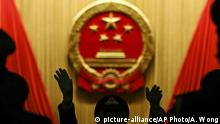 A military band conductor rehearses ahead of the closing session of the annual National People's Congress held in the Great Hall of the People in Beijing, China, Wednesday, March 15, 2017. (AP Photo/Andy Wong) |