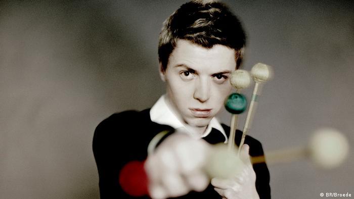 Martin Grubinger holding an array of drumsticks