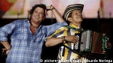 epa05052611 Colombian singer Carlos Vives (L) performs with Colombian musician Egidio Cuadrado (R) during a concert for children in Medellin, Colombia, 02 December 2015. During the concert Vives gave a tribute to the Colombian traditional music known as 'Vallenato' which recently was added on the list of Intangible Cultural Heritage in Need of Urgent Safeguarding by the United Nations Educational, Scientific and Cultural Organization (UNESCO). EPA/LUIS EDUARDO NORIEGA  