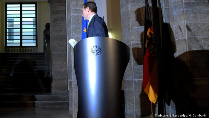 Karl-Theodor zu Guttenberg walks away from his post as German defense minister amid his plagiarism affair in March 2011 (picture-alliance/dpa/M. Gambarini)