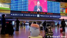 REFILE - CORRECTING DATE People watch the CCTV Spring Festival Gala TV show on a screen at the Beijing West train station in Beijing, China, February 15, 2018. REUTERS/Thomas Peter