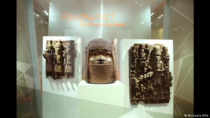 Photo of three bronzes in an exhibition