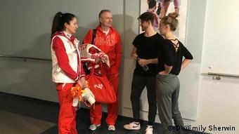 Ivan Bukin, Alexandra Stepanova and their trainer