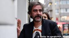 German-Turkish journalist Deniz Yucel arrives at his home in Istanbul on February 16, 2018 following his release from prison. Turkey ordered the release of German-Turkish journalist Deniz Yucel, held for more than a year without charge, which could remove a major hurdle to repairing ties between Ankara and Berlin. / AFP PHOTO / YASIN AKGUL (Photo credit should read YASIN AKGUL/AFP/Getty Images)