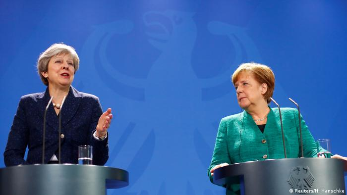Angela Merkel and Theresa May at a press conference