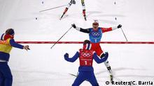Cross-Country Skiing - Pyeongchang 2018 Winter Olympics - Women's 4x5km Relay - Alpensia Cross-Country Skiing Centre - Pyeongchang, South Korea - February 17, 2018. Marit Bjoergen of Norway celebrates winning ahead of Stina Nilsson of Sweden. REUTERS/Carlos Barria