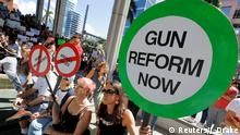 17.02.2018 Protesters hold signs as they call for a reform of gun laws three days after the shooting at Marjory Stoneman Douglas High School, at a rally in Fort Lauderdale, Florida, U.S., February 17, 2018. REUTERS/Jonathan Drake
