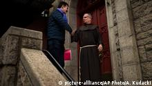 17.02.2018 Juan Carlos Cruz, left, shake hands with a member of the church as he leaves after a meeting with Archbishop Charles Scicluna at Roman Catholic church in New York, on Saturday, Feb. 17, 2018. The meeting between Scicluna and Cruz takes place the same day Pope Francis revived his lapsed sex abuse advisory commission by naming new members, after coming under fire for his overall handling of the scandal. (AP Photo/Andres Kudacki)