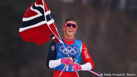Johannes Hoesflot Klaebo of Norway celebrates after crossing the finish line