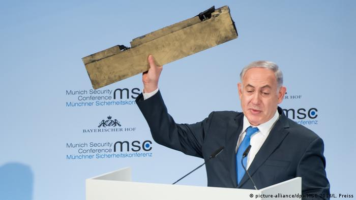 Israel's Netanyahu holding up a piece of a drone, allegedly from Iran