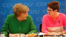 Chancellor Angela Merkel and Annegret Kramp-Karrenbauer (Reuters/H. Hanschke)
