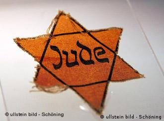 The yellow Jewish star that Jews had to wear during the Nazi regime