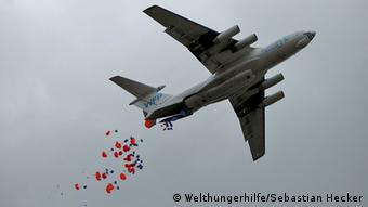 Aid being thrown from a carreier plane