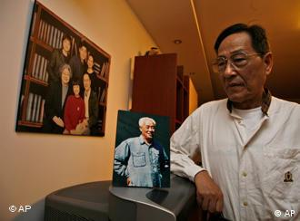 Bao Tong, right, poses for photo near a picture of Zhao Ziyang, the Chinese leader ousted for opposing the crackdown on the 1989 Tiananmen square democracy movement, at his home in Beijing, China, Friday, May 15, 2009. Bao who was then a top aide to Zhao, hopes Zhao's posthumous memoirs which are to be published just weeks before the 20th anniversary of the crackdown will provide lessons to China's future generation and top leaders. (AP Photo/Ng Han Guan)