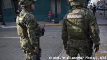 Mexican marines patrol downtown Matamoros, Tamaulipas, Mexico, Wednesday, March 22, 2017, across the border from Brownsville, Texas. (AP Photo/Rodrigo Abd)  