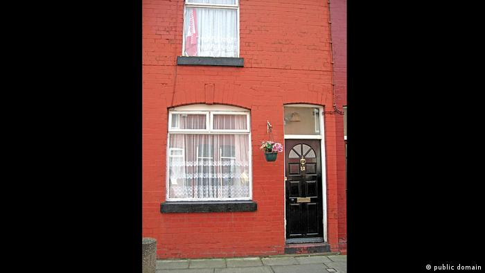 The red-facaded house in which George Harrison was born in Liverpool (public domain)