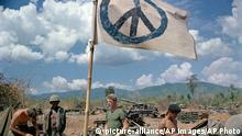 U.S. artillerymen relax under a crudely made peace flag at the Laotian border, 1971. The gunners were giving covering fire for South Vietnamese troops operating inside Laos. (AP Photo) |