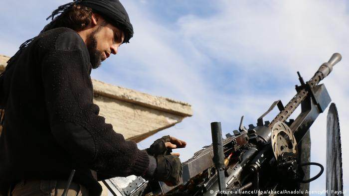 A member of Free Syrian Army aims his gun towards positions of PYD/PKK