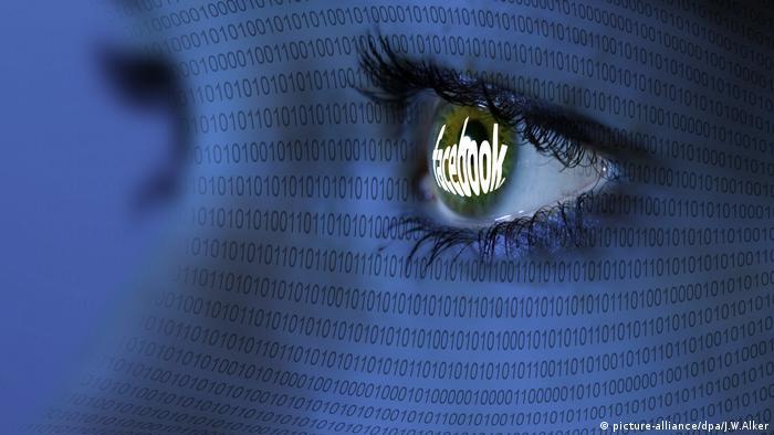A close-up of a woman's eye reflecting the Facebook logo