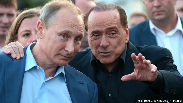 Russian President Vladimir Putin with former premier Silvio Berlusconi in 2015