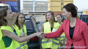 Four young women at a 2013 Girl's Day event at Vienna's Container Terminal at the city's river port (picture-alliance/H.Neubauer)