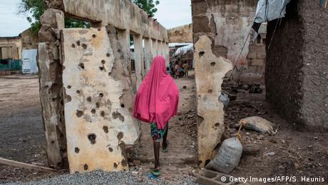 A girl walks through a camp for people displaced by Boko Haram
