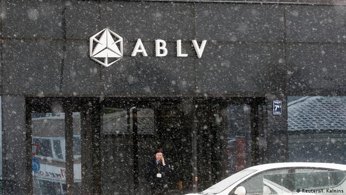 A security guard speaks on her mobile phone at the head office of the ABLV Bank
