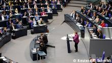 Merkel addressing the German parliament (Reuters/A. Schmidt)